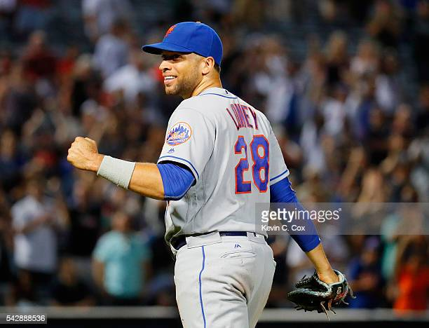 James Loney of the New York Mets reacts after making a play to tag first base after Jace Peterson of the Atlanta Braves struck out swinging to end...