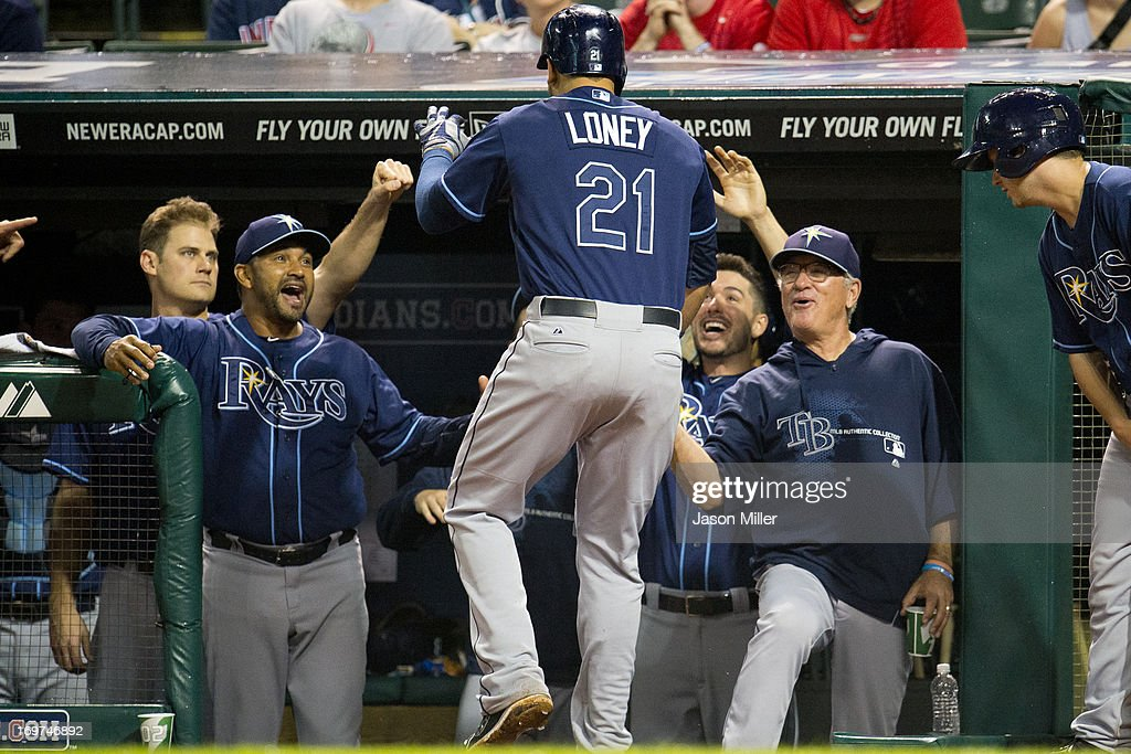 <a gi-track='captionPersonalityLinkClicked' href=/galleries/search?phrase=James+Loney&family=editorial&specificpeople=636293 ng-click='$event.stopPropagation()'>James Loney</a> #21 of the Tampa Bay Rays celebrates with teammates in the dugout after hitting a two run home run during the third inning against the Cleveland Indians at Progressive Field on June 1, 2013 in Cleveland, Ohio.