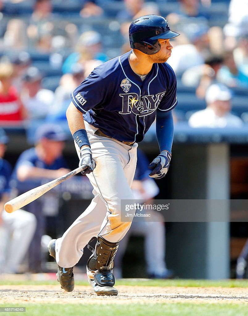 James Loney #21 of the Tampa Bay Rays follows through on a seventh inning base hit against the New York Yankees at Yankee Stadium on July 2, 2014 in the Bronx borough of New York City. The Rays defeated the Yankees 6-3.