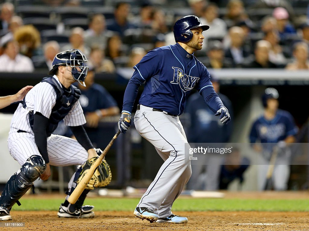 James Loney #21 of the Tampa Bay Rays hits a 2RBI double in the sixth inning as Chris Stewart #19 of the New York Yankees catches on September 24, 2013 at Yankee Stadium in the Bronx borough of New York City.