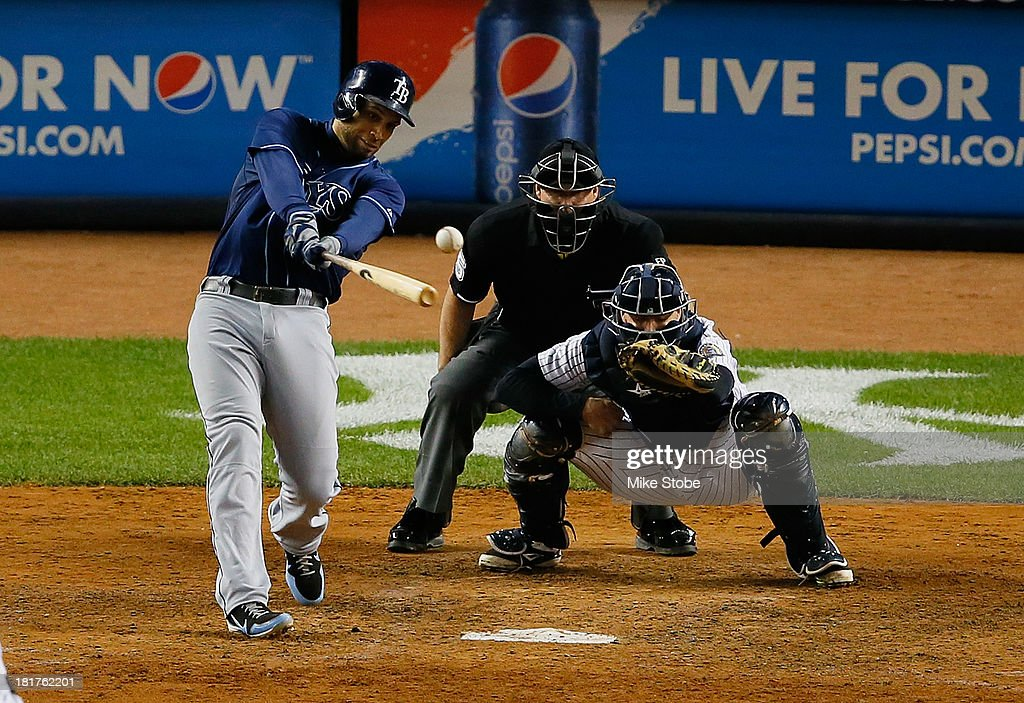 <a gi-track='captionPersonalityLinkClicked' href=/galleries/search?phrase=James+Loney&family=editorial&specificpeople=636293 ng-click='$event.stopPropagation()'>James Loney</a> #21 of the Tampa Bay Rays hits a two-run double in the sixth inning against the New York Yankees at Yankee Stadium on September 24, 2013 in the Bronx borough of New York City. The Rays defeated the Yankees 7-0.
