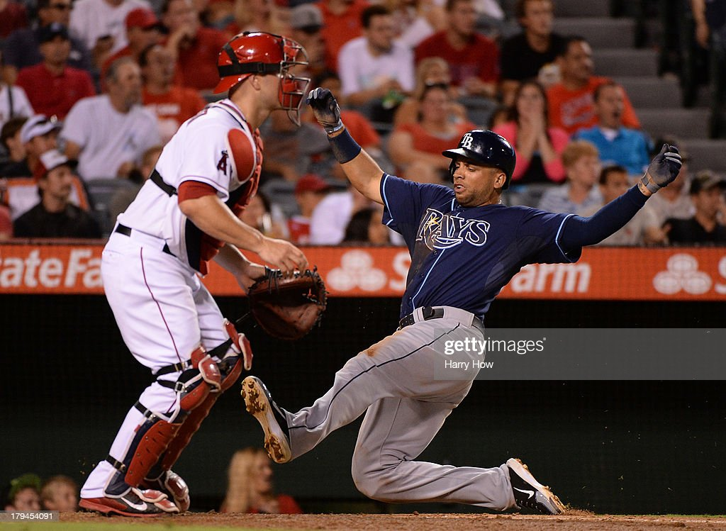 <a gi-track='captionPersonalityLinkClicked' href=/galleries/search?phrase=James+Loney&family=editorial&specificpeople=636293 ng-click='$event.stopPropagation()'>James Loney</a> #21 of the Tampa Bay Rays slides home for a run and a 5-1 lead in front of <a gi-track='captionPersonalityLinkClicked' href=/galleries/search?phrase=Chris+Iannetta&family=editorial&specificpeople=836137 ng-click='$event.stopPropagation()'>Chris Iannetta</a> #17 of the Los Angeles Angels during the fifth inning at Angel Stadium of Anaheim on September 3, 2013 in Anaheim, California.