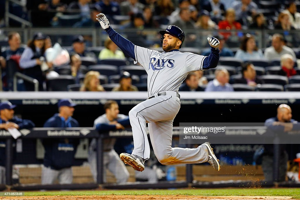 James Loney #21 of the Tampa Bay Rays slides home with a run in the sixth inning against the New York Yankees after a triple from teammate Logan Forsythe (not pictured) at Yankee Stadium on April 28, 2015 in the Bronx borough of New York City.