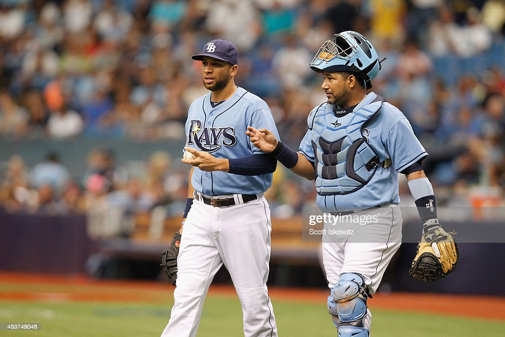 James Loney #21 of the Tampa Bay Rays talks with Jose Molina #28 of the Tampa Bay Rays during the first inning against the New York Yankees at Tropicana Field on August 17, 2014 in St Petersburg, Florida.