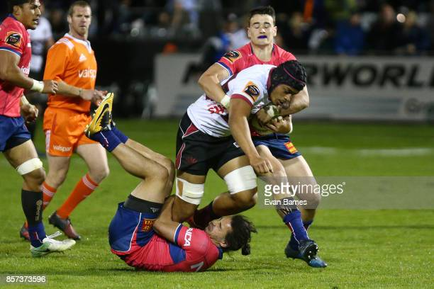 James Lowe and Will Jordan of Tasman tackle Gerard CowleyTuioti of North Harbour during the round eight Mitre 10 Cup match between Tasman and North...