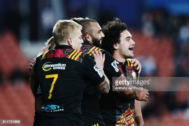 James Lowe of the Chiefs celebrates with teammates after scoring a try later ruled disallowed during the round 17 Super Rugby match between the...