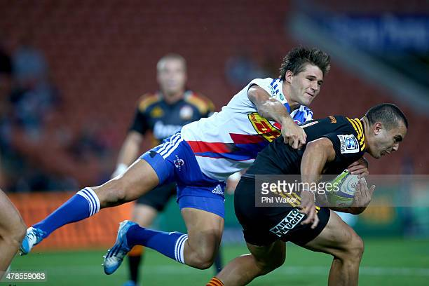 James Lowe of the Chiefs is tackled by Jacobus Petrus Van Wyk of the Stormers during the round five Super Rugby match between the Chiefs and the...