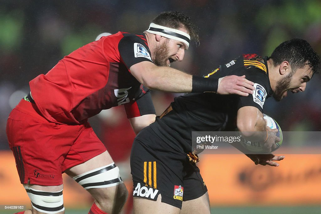 James Lowe of the Chiefs is tackled by Kieran Read of the Crusaders during the round 15 Super Rugby match between the Chiefs and the Crusaders at ANZ Stadium on July 1, 2016 in Suva, Fiji.