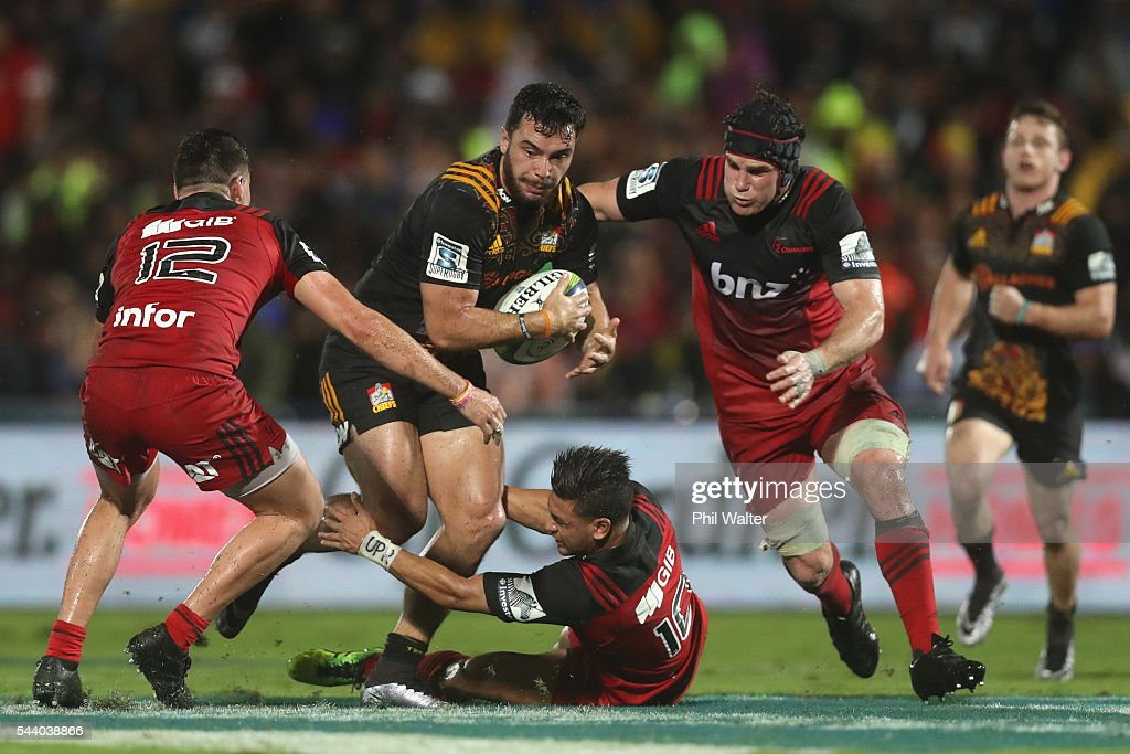James Lowe of the Chiefs is tackled by <a gi-track='captionPersonalityLinkClicked' href=/galleries/search?phrase=Richie+Mo%27unga&family=editorial&specificpeople=11403352 ng-click='$event.stopPropagation()'>Richie Mo'unga</a> of the Crusaders during the round 15 Super Rugby match between the Chiefs and the Crusaders at ANZ Stadium on July 1, 2016 in Suva, Fiji.