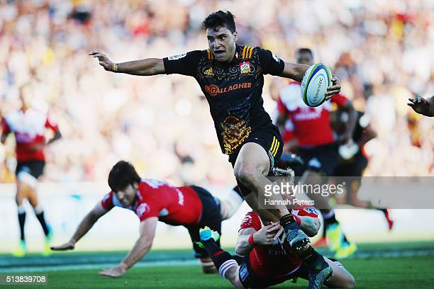 James Lowe of the Chiefs makes a break to score a try during the round two Super Rugby match between the Chiefs and the Lions at FMG Stadium on March...