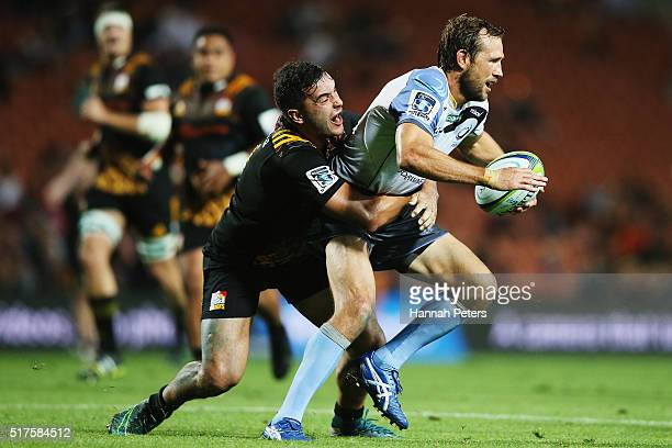James Lowe of the Chiefs tackles Peter Grant of the Force during the round five Super Rugby match between the Chiefs and the Western Force at FMG...