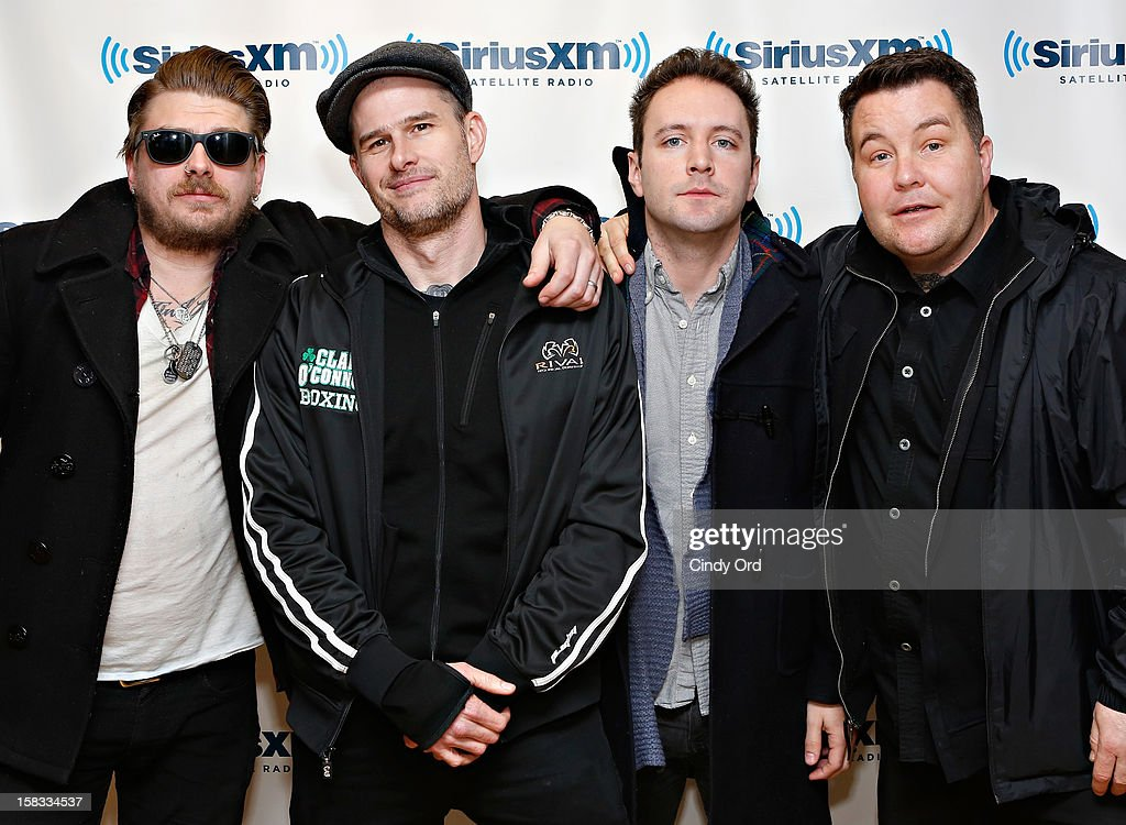James Lynch, Al Barr, Jeff DaRosa and Ken Casey of Dropkick Murphys visit the SiriusXM Studios on December 13, 2012 in New York City.