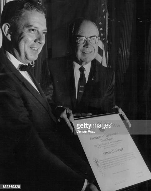James M Reese right receives Navy citation Jim Eakins president of Denver unit made presentation Credit Denver Post