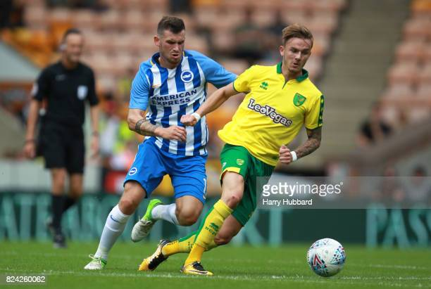 James Maddison of Norwich and Pascal Gross of Brighton in action during the preseason friendly match between Norwich City and Brighton Hove Albion at...
