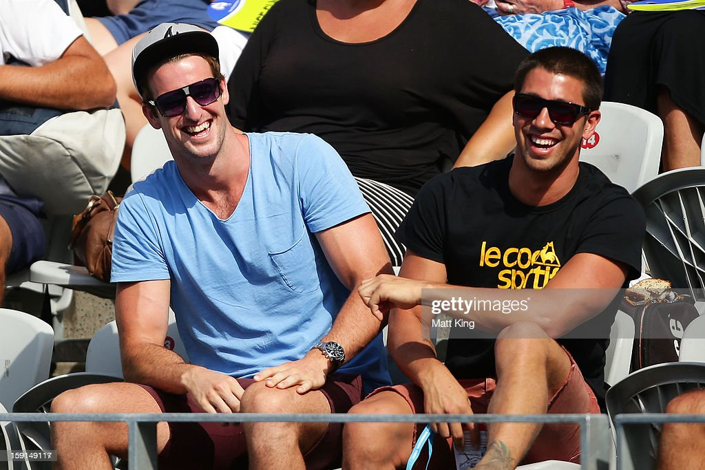 James Magnussen (L) attends the second round match between Bernard Tomic of Australia and Florian Mayer of Germany during day four of the Sydney International at Sydney Olympic Park Tennis Centre on January 9, 2013 in Sydney, Australia.