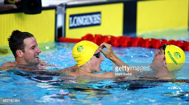 James Magnussen of Australia celebrates winning the gold medal in the Men's 100m Freestyle Final with silver medallist Cameron McEvoy and bronze...