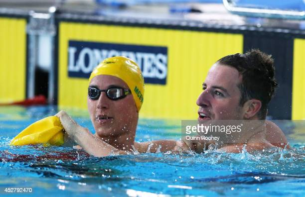 James Magnussen of Australia celebrates winning the gold medal in the Men's 100m Freestyle Final with silver medallist Cameron McEvoy of Australia at...