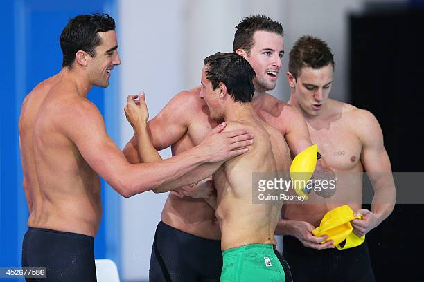 James Magnussen of Australia celebrates with team mates Cameron McEvoy Matt Abood and Tommaso D'Orsogna after winning the gold medal in the Men's 4 x...