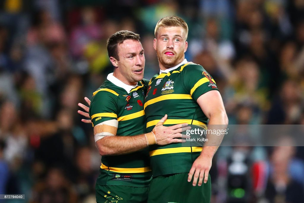 James Maloney and Cameron Munster of Australia celebrate Munster scoring a try during the 2017 Rugby League World Cup match between Australia and Lebanon at Allianz Stadium on November 11, 2017 in Sydney, Australia.