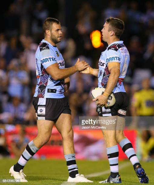 James Maloney is congratulated by Wade Graham of the Sharks after scoring a try during the round 11 NRL match between the Cronulla Sharks and the...