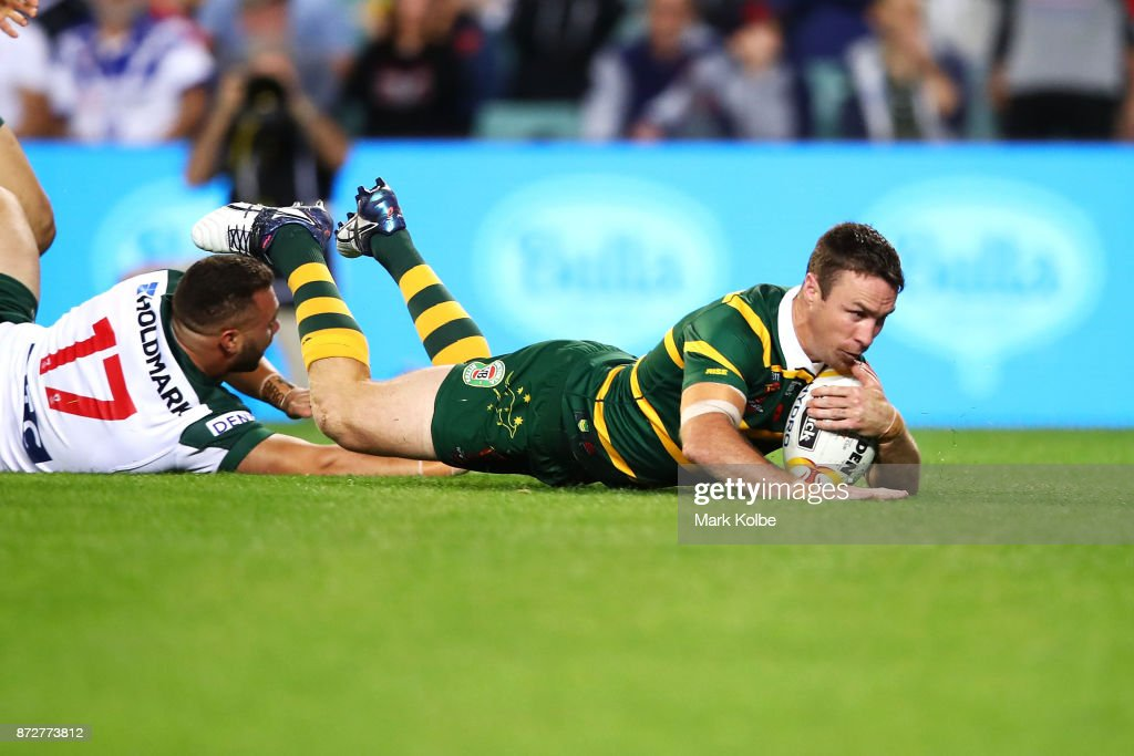 James Maloney of Australia dives over to score a try during the 2017 Rugby League World Cup match between Australia and Lebanon at Allianz Stadium on November 11, 2017 in Sydney, Australia.