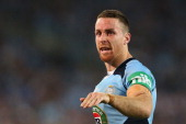 James Maloney of the Blues gives instructions during game three of the ARL State of Origin series between the New South Wales Blues and the...