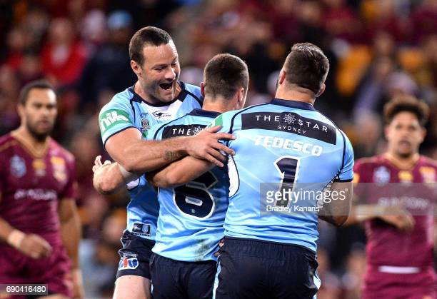 James Maloney of the Blues is congratulated by team mates after scoring a try during game one of the State Of Origin series between the Queensland...