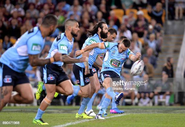 James Maloney of the Blues kicks off during game one of the State Of Origin series between the Queensland Maroons and the New South Wales Blues at...