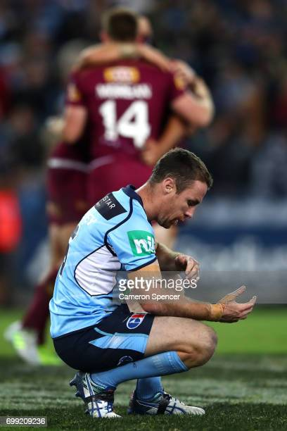 James Maloney of the Blues looks dejected after losing game two of the State Of Origin series between the New South Wales Blues and the Queensland...