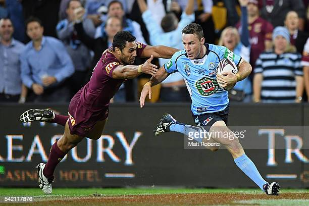 James Maloney of the Blues runs in for a try during game two of the State Of Origin series between the Queensland Maroons and the New South Wales...