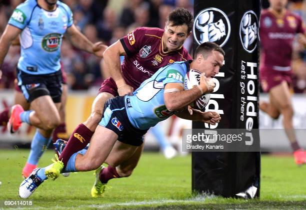 James Maloney of the Blues scores a try during game one of the State Of Origin series between the Queensland Maroons and the New South Wales Blues at...