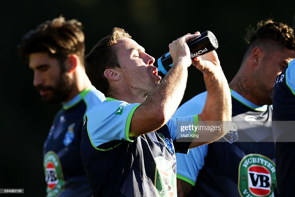 <a gi-track='captionPersonalityLinkClicked' href=/galleries/search?phrase=James+Maloney&family=editorial&specificpeople=2672556 ng-click='$event.stopPropagation()'>James Maloney</a> of the Blues takes a drinks break during a New South Wales Blues State of Origin training session on May 25, 2016 in Coffs Harbour, Australia.