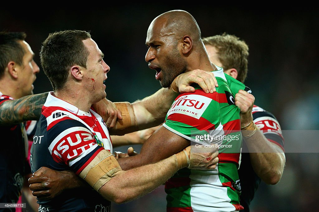 James Maloney of the Roosters and Lote Tuqiri of the Rabbitohs have and altercation during the round 26 NRL match between the Sydney Roosters and the South Sydney Rabbitohs at Allianz Stadium on September 4, 2014 in Sydney, Australia.