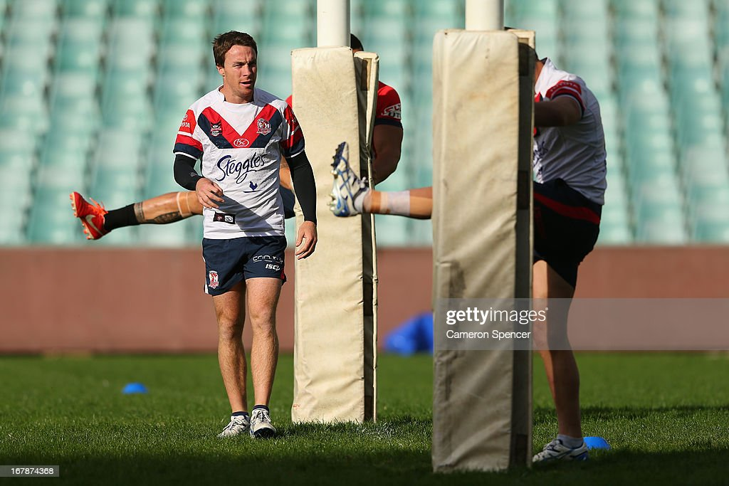 James Maloney of the Roosters and team mates warm up during a Sydney Roosters NRL training session at Moore Park on May 2, 2013 in Sydney, Australia.