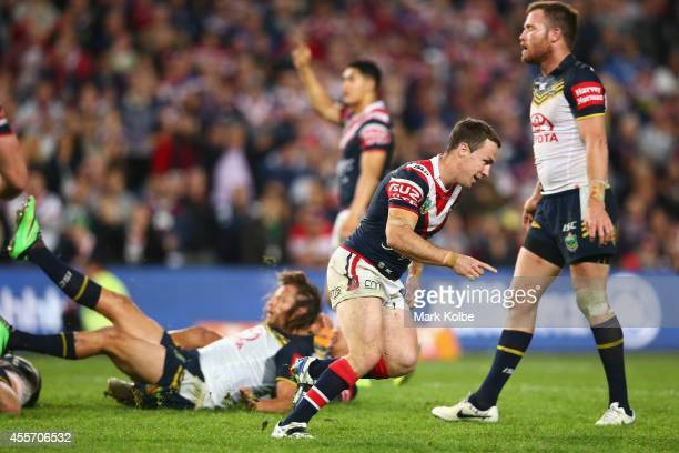 James Maloney of the Roosters celebrates kicking the winning field goal during the 1st NRL Semi Final match between the Sydney Roosters and the North...