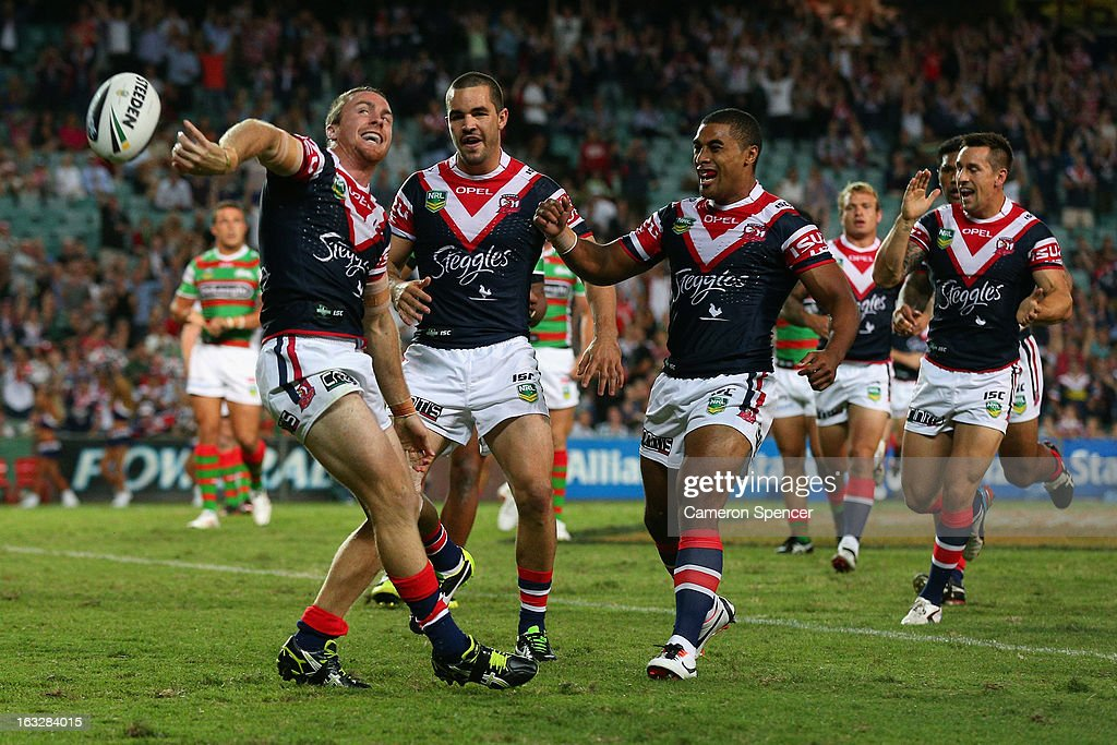 James Maloney of the Roosters celebrates scoring a try during the round one NRL match between the Sydney Roosters and the South Sydney Rabbitohs at Allianz Stadium on March 7, 2013 in Sydney, Australia.