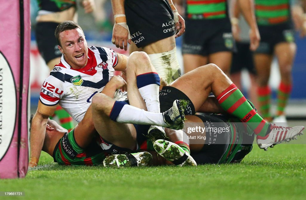 James Maloney of the Roosters celebrates scoring his second half try during the round 26 NRL match between the South Sydney Rabbitohs and the Sydney Roosters at ANZ Stadium on September 6, 2013 in Sydney, Australia.
