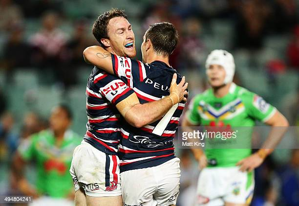 James Maloney of the Roosters celebrates with Mitchell Pearce after scoring a try during the round 12 NRL match between the Sydney Roosters and the...