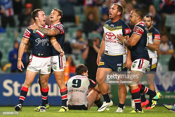 James Maloney of the Roosters is congratulated by team mate Jake Friend of the Roosters after scoring a try during the 1st NRL Semi Final match...