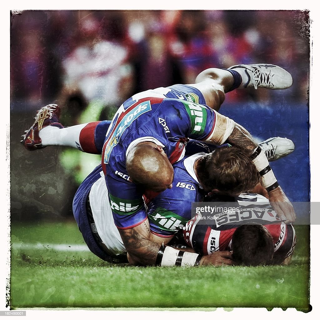 James Maloney of the Roosters is tackled during the NRL Preliminary Final match between the Sydney Roosters and the Newcastle Knights at Allianz Stadium on September 28, 2013 in Sydney, Australia.