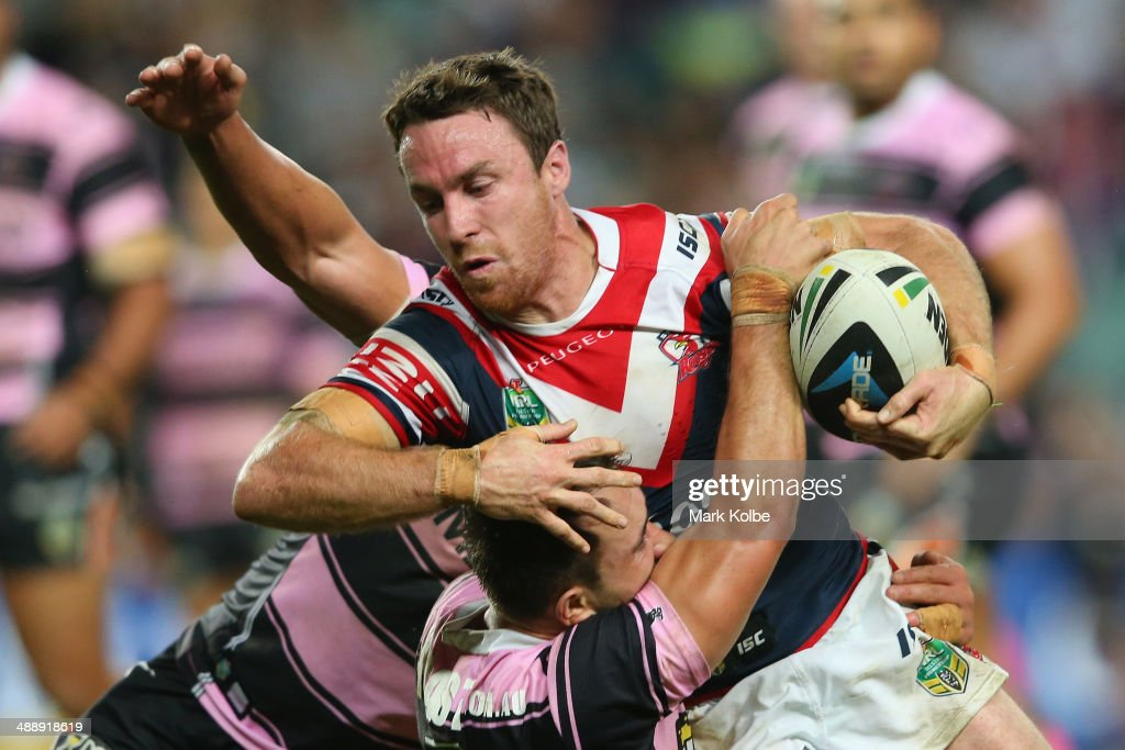 <a gi-track='captionPersonalityLinkClicked' href=/galleries/search?phrase=James+Maloney&family=editorial&specificpeople=2672556 ng-click='$event.stopPropagation()'>James Maloney</a> of the Roosters is tackled during the round nine NRL match between the Sydney Roosters and the Wests Tigers at Allianz Stadium on May 9, 2014 in Sydney, Australia.