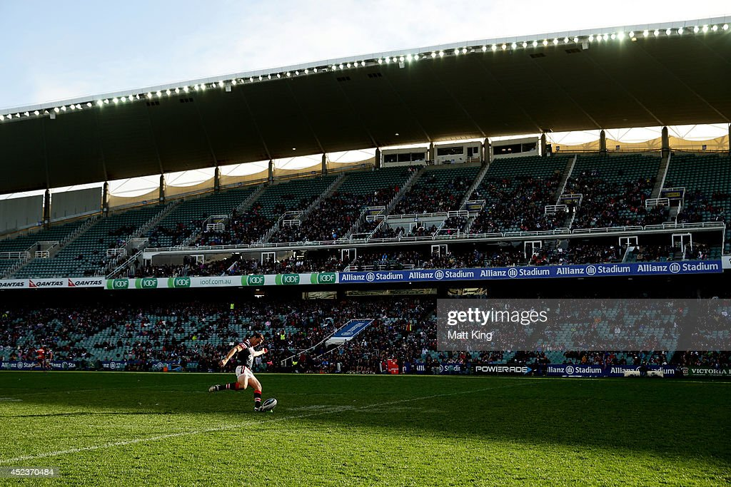 <a gi-track='captionPersonalityLinkClicked' href=/galleries/search?phrase=James+Maloney&family=editorial&specificpeople=2672556 ng-click='$event.stopPropagation()'>James Maloney</a> of the Roosters kicks a conversion during the round 19 NRL match between the Sydney Roosters and the Penrith Panthers at Allianz Stadium on July 19, 2014 in Sydney, Australia.