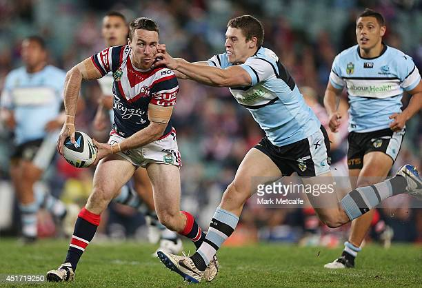 James Maloney of the Roosters looks to pass during the round 17 NRL match between the Sydney Roosters and the Cronulla Sharks at Allianz Stadium on...