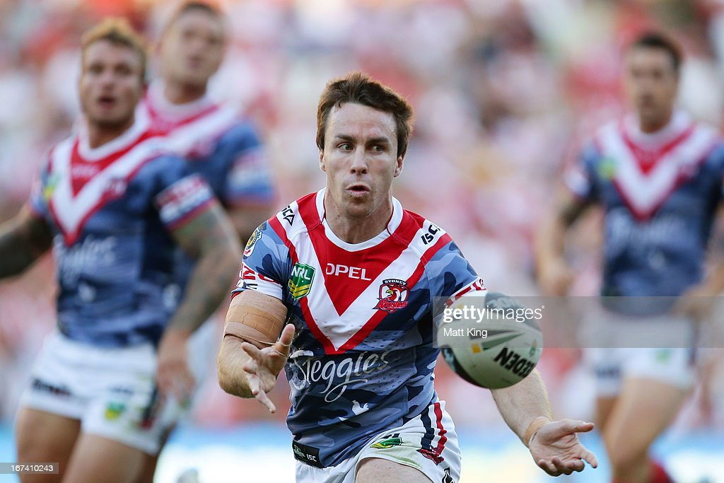 James Maloney of the Roosters passes during the round seven NRL match between the Sydney Roosters and the St George Illawarra Dragons at Allianz Stadium on April 25, 2013 in Sydney, Australia.