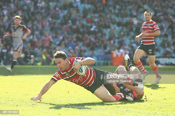James Maloney of the Roosters scores a try during the round 19 NRL match between the Sydney Roosters and the New Zealand Warriors at Allianz Stadium...