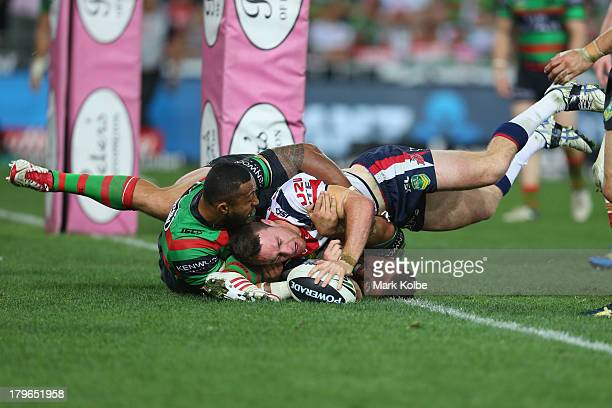 James Maloney of the Roosters scores a try during the round 26 NRL match between the South Sydney Rabbitohs and the Sydney Roosters at ANZ Stadium on...