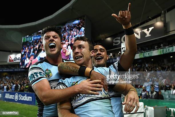 James Maloney of the Sharks celebrates with his team mates after scoring a try during the NRL Preliminary Final match between the Cronulla Sharks and...