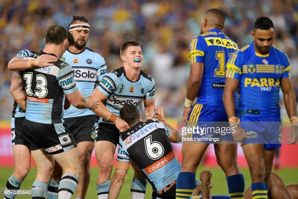 James Maloney of the Sharks celebrates with Jayden Brailey of the Sharks after scoring during the round four NRL match between the Parramatta Eels...