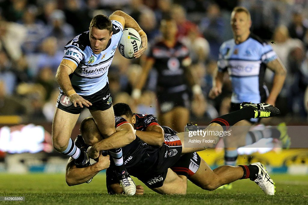 James Maloney of the Sharks is tackled by the Warriors defence during the round 16 NRL match between the Cronulla Sharks and the New Zealand Warriors at Southern Cross Group Stadium on June 25, 2016 in Sydney, Australia.