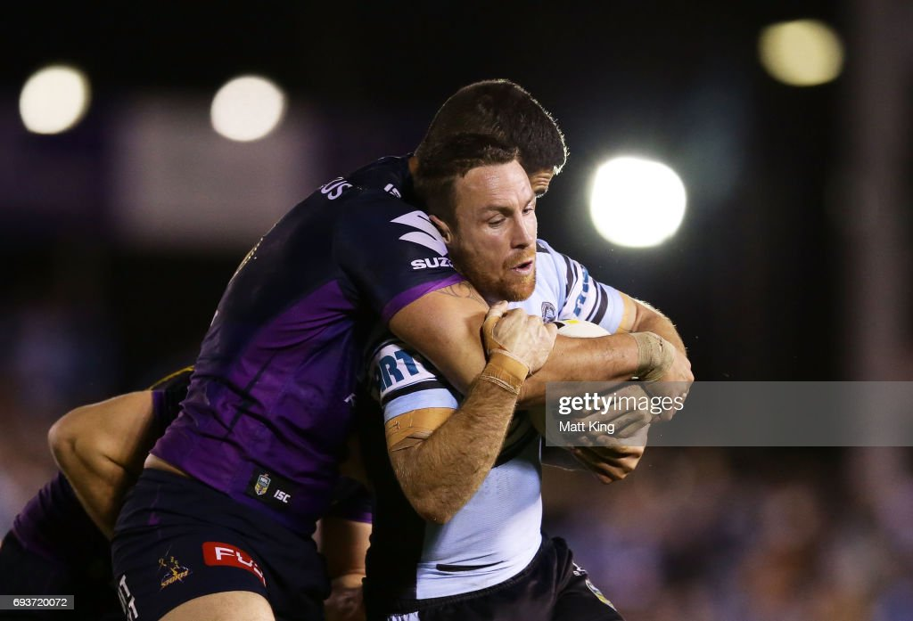 James Maloney of the Sharks is tackled during the round 14 NRL match between the Cronulla Sharks and the Melbourne Storm at Southern Cross Group Stadium on June 8, 2017 in Sydney, Australia.